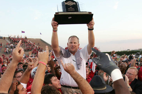 Coach Jay Thomas Hoists Conference Championship Trophy